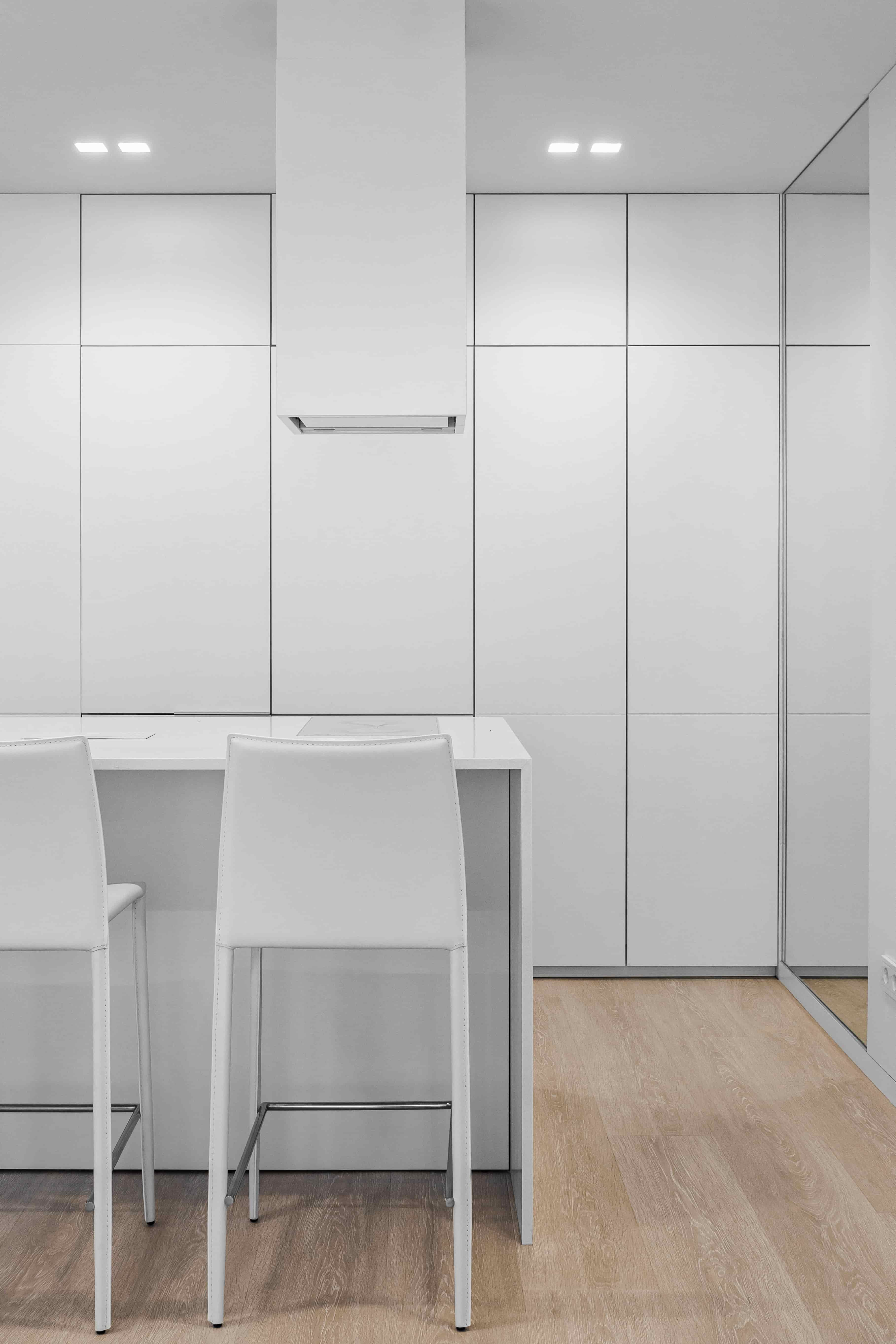 white minimalist modern kitchen island design detail